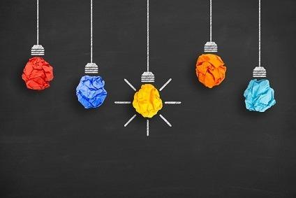 Crumpled Paper Light Bulb Idea Concept on Blackboard