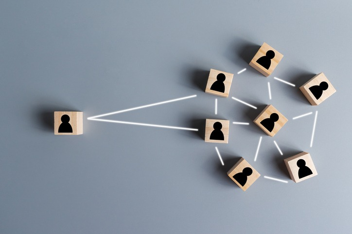 concept of Human resources and management, building teamwork, strong leader connect to coworker, people icon on wooden cube, cooperation and organization