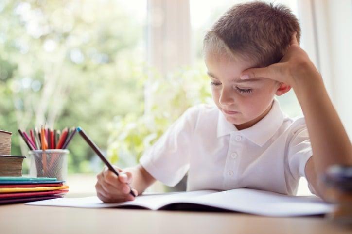 Boy doing his school work or homework