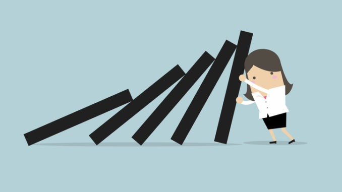 illustration of figure holding up falling dominoes