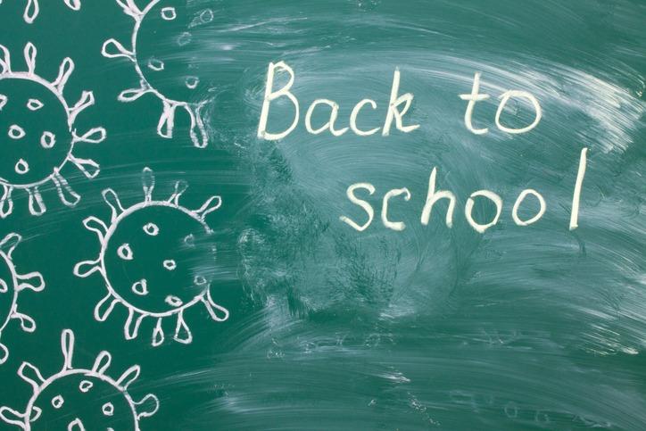 writing on a green chalkboard – back to school