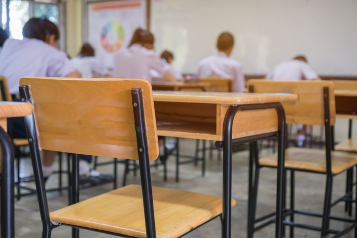 Lecture room or School empty classroom with Student taking exams, writing examination for studying lessons in high school thailand, interior of secondary education, whiteboard. educational concept